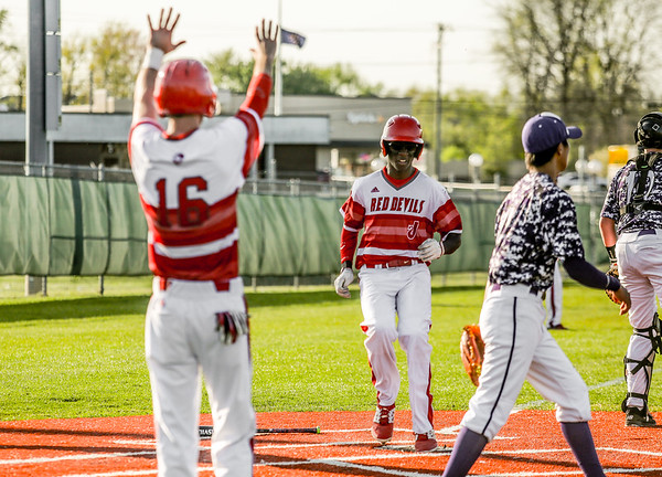 Jeffersonville's Bennie Day lands on home plate on the heels of Michael Minton, scoring two runs against Seymour on Thursday. Staff Photo By Josh Hicks