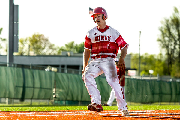 Jeffersonville's Ethan English scores a run during the Red Devils' game against Seymour on Thursday. Staff Photo By Josh Hicks