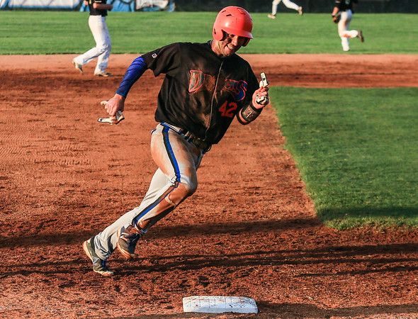 Silver Creek's Justin Brown rounds third base during the Dragons' win against Corydon on Saturday. Staff Photo By Josh Hicks
