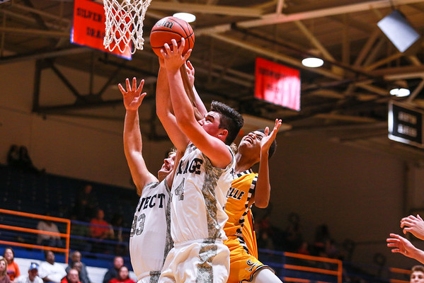 Silver Creek's Jacob Garrett, left, and Josh Landers jump in unison to block Clarksville's Tyler Martin from getting the rebound during their game at Silver Creek on Friday. Staff Photo By Josh Hicks
