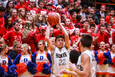 Silver Creek's Ty Kessinger looks for an open man while the student section and chearleaders show their support during their game against Clarksville on Friday. Staff Photo By Josh Hicks