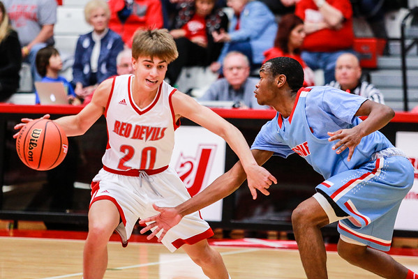 Jeffersonville's Joe LaGrange fakes out the Ft. Wayne defense, carrying the ball to the basket during their game at Johnson Arena on Saturday. Staff Photo By Josh Hicks