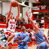 Jeffersonville's Bailey Falkenstein flies over Ft. Wayne for a mid-air shot during their game at Johnson arena on Saturday. Staff Photo By Josh Hicks