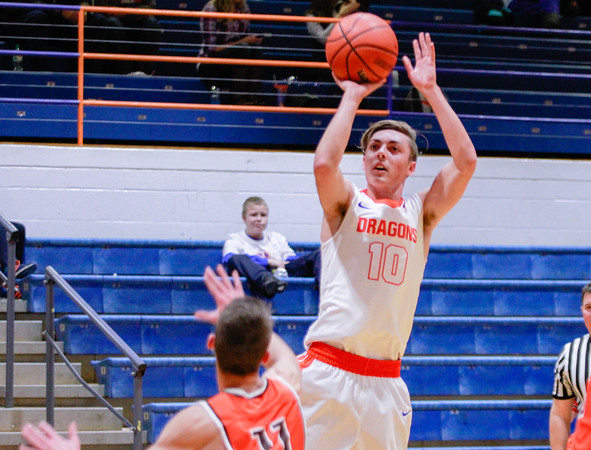 Silver Creek's Zane Gross takes a jump shot during their 56-47 win against Columbus East at Silver Creek High School on Saturday. Staff Photo By Josh Hicks