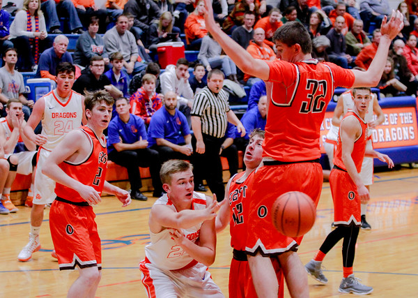Silver Creek's Bennett Beyl makes a swift pass from underneath the basket during their 56-47 win against Columbus East on Saturday. Staff Photo By Josh Hicks