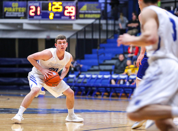 Charlestown's Trey Schafer makes eye contact just before making a solid pass during their game against New Washington on Tuesday. Staff Photo By Josh Hicks