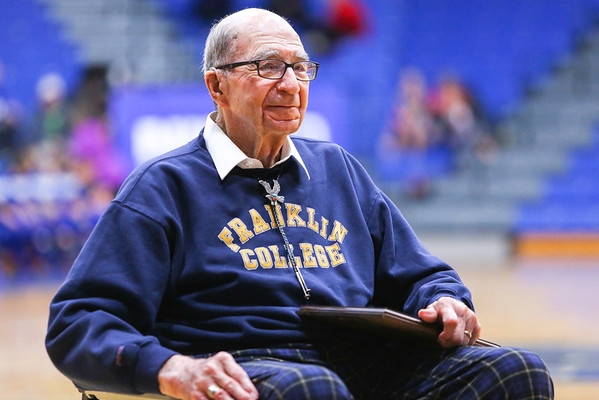 Former coach Billy Abel makes his way across Charletown High School's basketball court with a congratulatory plaque on Tuesday, November 22nd, 2016. Abel is the oldest living coach in Charlestown at the age of ninety-five. Staff Photo By Josh Hicks