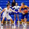 New Washington's Zach Moore tries to find a way around Charletown during their game on Tuesday. Staff Photo By Josh Hicks