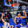 New Washington's Stevie Mack goes in for a lay up against Charlestown on Tuesday. Staff Photo By Josh Hicks