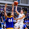 Charlestown's Jordon Knoebel passes over New Washington for a short-range shot during their game on Tuesday. Staff Photo By Josh Hicks
