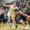 Providence guard Nick Boesing drives past Floyd Central's Brendon Hobson during the Highlanders' 59-41 win over the Pioneers on Friday. Staff photo by Tyler Stewart