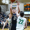 Providence forward Alex Judd puts up a shot over Floyd Central's Brendon Hobson during the Highlanders' 59-41 win over the Pioneers on Friday. Staff photo by Tyler Stewart