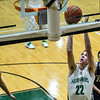 Floyd Central forward Brendon Hobson takes the ball past the Providence defenders for a layup during the Highlanders' 59-41 win over the Pioneers on Friday. Staff photo by Tyler Stewart