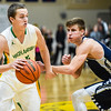 Floyd Central guard Tyler Kimm carries the ball past Providence defender Juston Betz during the Highlanders' 59-41 win over the Pioneers on Friday. Staff photo by Tyler Stewart