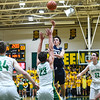 Providence guard Nick Boesing pulls up for a short-range jumpshot over the Floyd Central defense during the Highlanders' 59-41 win over the Pioneers on Friday. Staff photo by Tyler Stewart