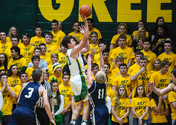 Floyd Central's Luke Gohmann pulls up for a jumpshot over the Providence defenders during the Highlanders' 59-41 win over the Pioneers on Friday. Staff photo by Tyler Stewart