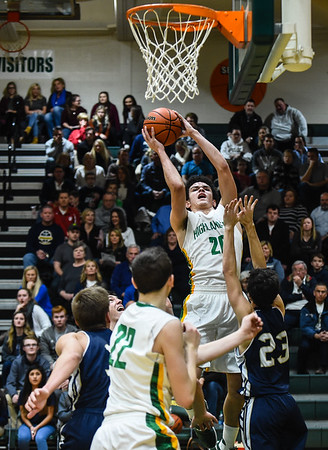 Floyd Central forward Kobie Barnes gets the layup over the Providence defenders during the Highlanders' 59-41 win over the Pioneers on Friday. Staff photo by Tyler Stewart