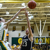 Floyd Central's Brendon Hobson blocks the layup by Providence's Nick Boesing during the Highlanders' 59-41 win over the Pioneers on Friday. Staff photo by Tyler Stewart