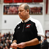 New Albany head coach Jim Shannon watches his team after calling an in-bound play during the Bulldogs' 55-52 win over Carmel on Tuesday. Staff photo by Tyler Stewart