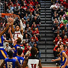 New Albany forward Romeo Langford dunks the ball over the Carmel defense during the Bulldogs' 55-52 win over the Greyhounds on Tuesday. Staff photo by Tyler Stewart