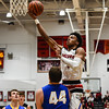 New Albany forward Romeo Langford gets a layup over the Carmel defender during the Bulldogs' 55-52 win over the Greyhounds on Tuesday. Staff photo by Tyler Stewart