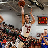 New Albany guard Isaac Hibbard throws up a shot after drawing a foul on the Carmel defense during the Bulldogs' 55-52 win over the Greyhounds on Tuesday. Staff photo by Tyler Stewart