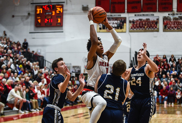 New Albany's Romeo Langford takes the ball into the Providence defenders while attempting a layup during the Bulldogs' 55-40 win over the Pioneers on Friday. Staff photo by Tyler Stewart