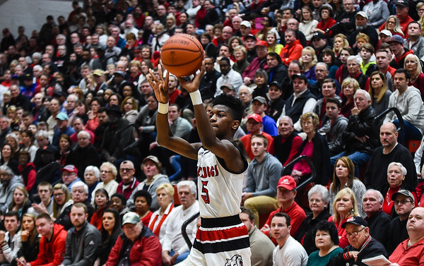 New Albany guard Sean East takes a 3-pointer during the Bulldogs' 55-40 win over Providence on Friday. Staff photo by Tyler Stewart