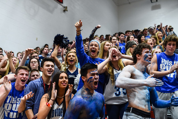 The Providence student section reacts to a play during the Pioneers' 55-40 loss to New Albany on Friday. Staff photo by Tyler Stewart