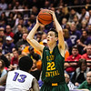 Floyd Central's Brendon Hobson looks for a pass over Seymour's Jordan Miller during the Hilanders' 44-26 Class 4A Sectional Semifinals win over the Fighting Owls at Lloyd E. Scott Gymnasium on Friday. Staff Photo By Josh Hicks