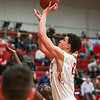 Indiana University Southeast's Tyler Landry puts the ball back up during the Grenadiers' 90-81 RSC Tournament Semifinal win over West Virginia Tech at the IUS athletic facility on Saturday. Staff Photo By Josh Hicks