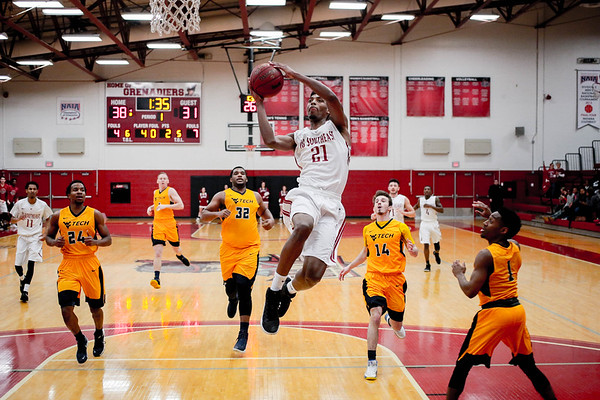 Indiana University Southeast's Joe Jackson flys in for two points during the Grenadiers' 90-81 RSC Tournament Semifinal win over West Virginia Tech at the IUS athletic facility on Saturday. Staff Photo By Josh Hicks