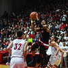 New Albany forward Romeo Langford finds a lane for a layup between the Jeffersonville defenders during the Bulldogs' 67-56 win over the Red Devils on Friday. Staff photo by Tyler Stewart