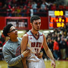 Jeffersonville forward Michael Minton is congratulated by a team manager after hitting a half court shot at the buzzer during New Albany's 67-56 win over the Red Devils on Friday. Staff photo by Tyler Stewart