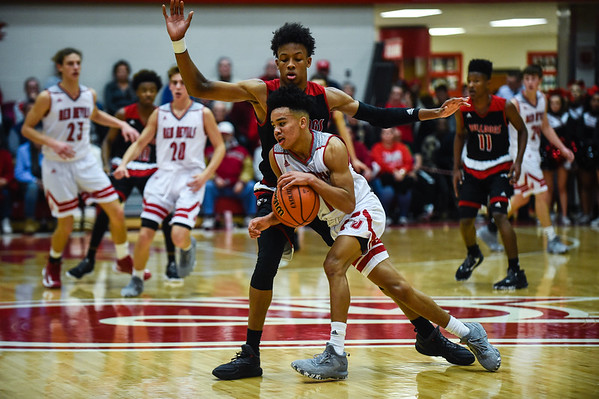 Jeffersonville guard Jacob Jones is pressured by New Albany's Romeo Langford at half court during the Bulldogs' 67-56 win over the Red Devils on Friday. Staff photo by Tyler Stewart
