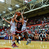 New Albany guard Isaac Hibbard attempts to break through the Jeffersonville defense for a shot during the Bulldogs' 67-56 win over the Red Devils on Friday. Staff photo by Tyler Stewart
