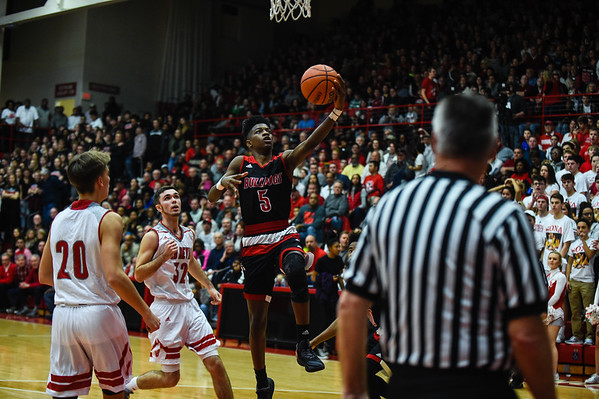 New Albany guard Sean East beats the Jeffersonville defense for a  layup off a fast break during the Bulldogs' 67-56 win over the Red Devils on Friday. Staff photo by Tyler Stewart