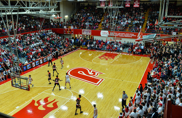 Jeffersonville guard Jacob Jones carries the ball toward the New Albany defense in front of a sold out crowd at Johnson Arena during the Bulldogs' 67-56 win over the Red Devils on Friday. Staff photo by Tyler Stewart