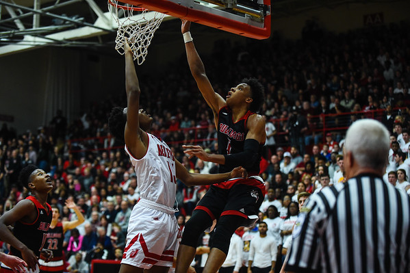 New Albany forward Romeo Langford gets the basket over Jeffersonville's Tre Coleman during the Bulldogs' 67-56 win over the Red Devils on Friday. Staff photo by Tyler Stewart