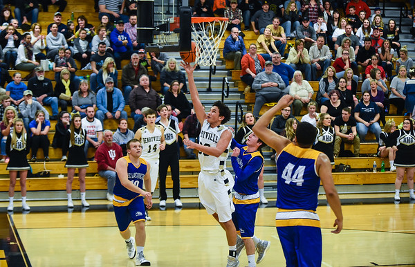 Henryville guard Nick Walker beats the New Washington defense for a layup during the Hornets' 57-33 win over the Mustangs on Friday. Staff photo by Tyler Stewart