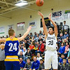Henryville guard Nick Walker pulls up for a 3-pointer over the New Washington defense during the Hornets' 57-33 win over the Mustangs on Friday. Staff photo by Tyler Stewart
