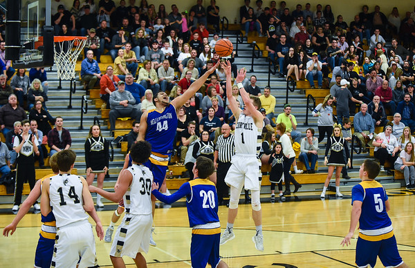 Henryville forward Braxton Robertson pulls up for a short-range shot over New Washington center Stevie Mack during the Hornets' 57-33 win over the Mustangs on Friday. Staff photo by Tyler Stewart