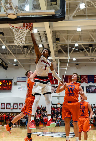 New Albany forward Romeo Langford get the one-handed dunk over the Silver Creek defense during the Bulldogs' 76-61 win over the Dragons on Friday. Staff photo by Tyler Stewart
