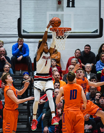 New Albany forward Romeo Langford dunks gets the reverse dunk over the Silver Creek defenders during the Bulldogs' 76-61 win over the Dragons on Friday. Staff photo by Tyler Stewart