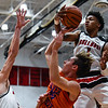 New Albany's Romeo Langford attempts a block on Silver Creek guard Keaton Goss during the Bulldogs' 76-61 win over the Dragons on Friday. Staff photo by Tyler Stewart