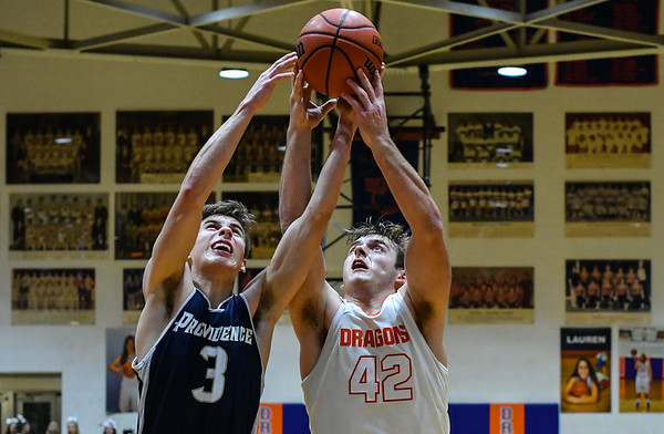 Providence guard Juston Betz and Silver Creek's fight for the rebound off a missed shot during the Pioneers' 42-37 win over the Dragons on Tuesday. Staff photo by Tyler Stewart