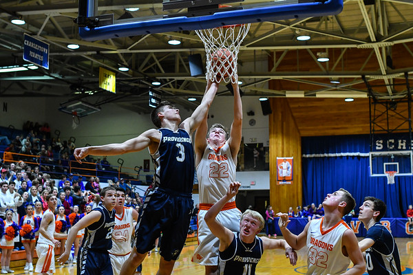 Silver Creek's Bennett Beyl contests the rebound against Providence's Juston Betz during the Pioneers' 42-37 win over the Dragons on Tuesday. Staff photo by Tyler Stewart