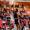Jeffersonville's Tre Coleman battles his way up to the basket during the Red Devils' game against Ballard at Johnson Arena on Friday. Staff Photo By Josh Hicks