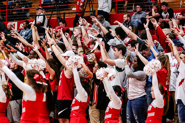 The Jeffersonville student section projects good luck onto the Red Devils as the team steps up for a free throw during the Red Devils' game against Ballard at Johnson Arena on Friday. Staff Photo By Josh Hicks
