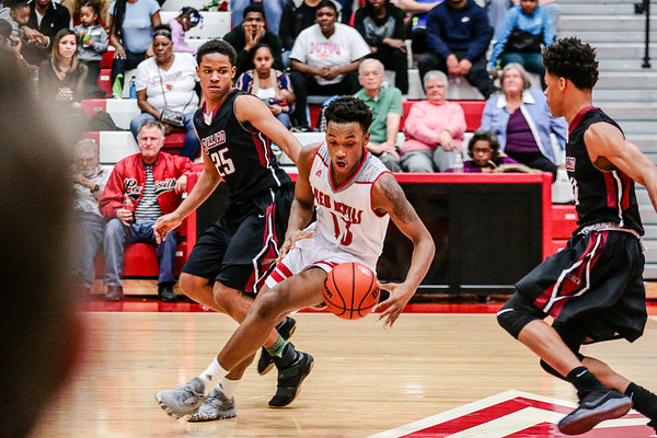 Jeffersonville's Tre Coleman gains control of the ball during the Red Devils' game against Ballard at Johnson Arena on Friday. Staff Photo By Josh Hicks
